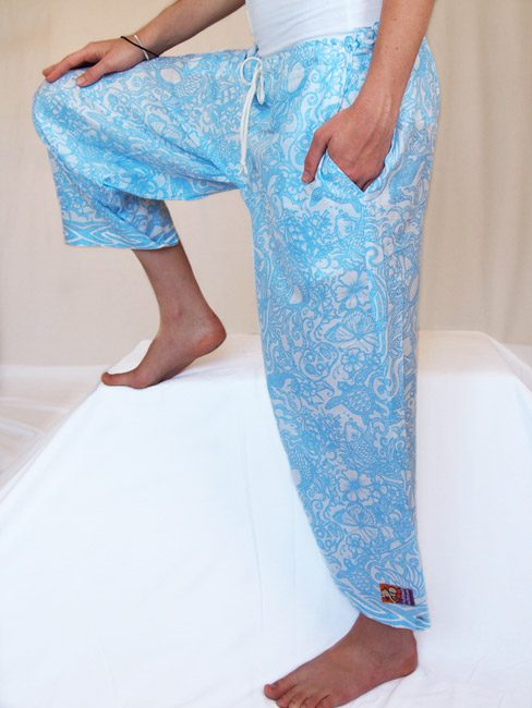 blue and white cotton beach pants with tattoos and sea creatures. great travel pants