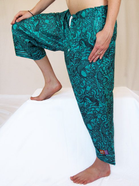 black and jade cotton beach pants with tattoos and sea creatures. great travel pants