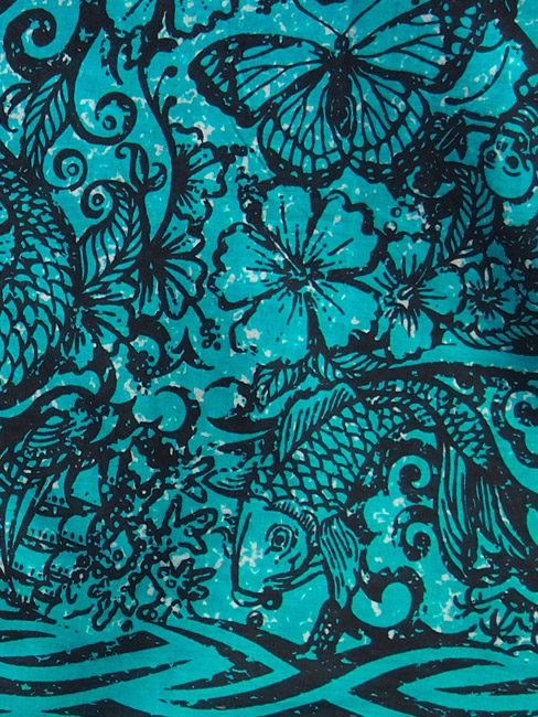 Black and jade cotton sarong or beach cover up with a tattooed design of mermaids and sea creatures Close up