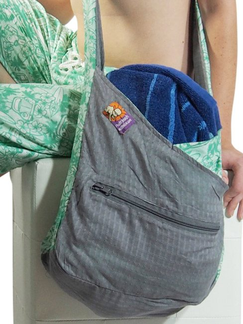 cotton beach bag or tote bag. three compartment shoulder bag for the beach. folds into a small zip pocket