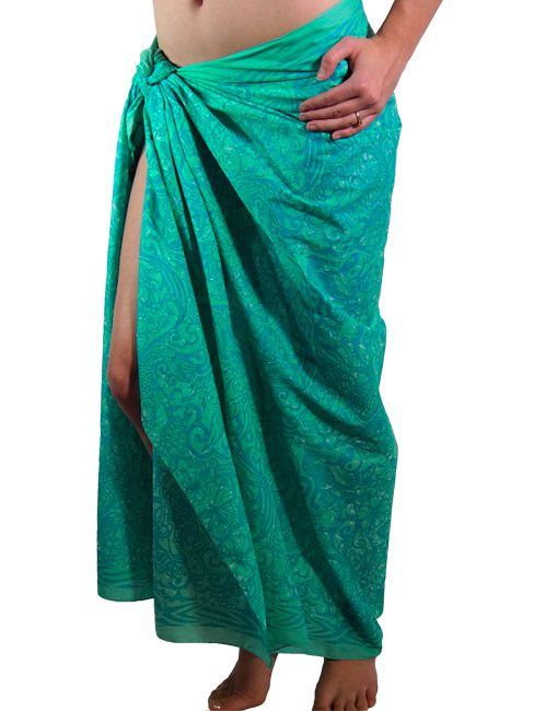 aqua and turquoise cotton sarong or beach cover up with a tattooed design of mermaids and sea creatures.