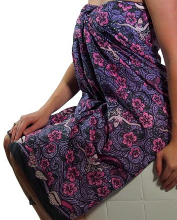 cotton sarong or pareo with dreamy mermaids floating on hibiscus. summer beach cover up