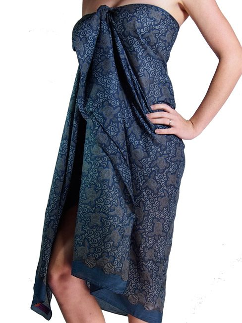 cotton sarong or pareo with turtles made out of shells swimming in the sea. summer beach cover up